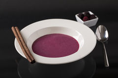 Mulberry cream soup on the plate on the dark background Royalty Free Stock Image