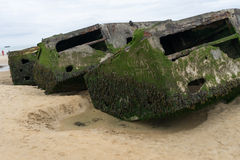 Mulberry Harbour. Remains of Mulberry harbor on the Gold beach in Normandy,arromanches,France royalty free stock photo
