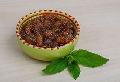 Mulberry jam. With mint leaves on the wood background royalty free stock images