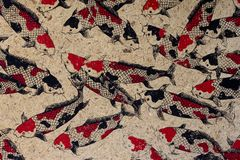 Mulberry paper with carp fishes. Texture background royalty free stock photo