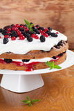 Mulberry and red currant cake with whipped cream. Mulberry and red currant cake with yogurt and whipped cream Royalty Free Stock Image