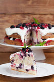 Mulberry and red currant cake with whipped cream. Mulberry and red currant cake with yogurt and whipped cream. Shallow dof Stock Photography