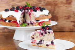 Mulberry and red currant cake. With yogurt and whipped cream stock photo