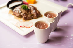 Mulberry Vinegar Juice with steak in background Royalty Free Stock Photography