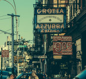 MulberryST Grotta Azurra. Many posters and people walking Royalty Free Stock Image