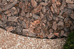 Mulch from the bark of pine trees Royalty Free Stock Photos