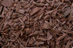 Mulch Brown Decorative Bark. Mulch Brown Coloured Decorative Bark garden decoration on the soil texture photography Stock Photo
