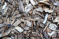 Mulch Chippings and Pieces Covering the Ground. Bits and pieces of wood mulch chippings covering the ground royalty free stock image