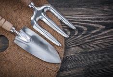 Mulching circle shovel trowel fork on wood board gardening conce Royalty Free Stock Image