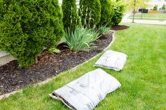 Mulching flowerbeds around the house Stock Photo