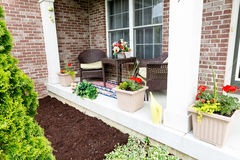 Mulching flowerbeds around the house Stock Photo