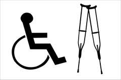 Muletas y siluetas del sillón de ruedas Foto de archivo libre de regalías