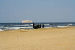 Mulher árabe em uma praia Imagens de Stock Royalty Free