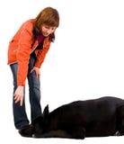 A mulher é treinamento do cão Fotos de Stock