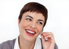 A mulher é um operador do telefone da sustentação foto de stock royalty free