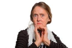 A mulher adulta é preocupada imagem de stock royalty free