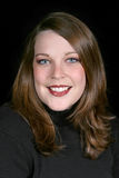 Mulher adulta bonita de Twenty-Five anos no preto Imagens de Stock Royalty Free