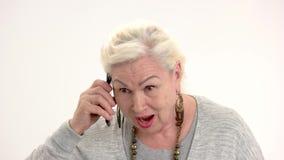 Mulher adulta surpreendida com telefone video estoque