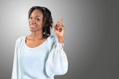 A mulher afro-americano veio acima com a ideia Fotos de Stock Royalty Free