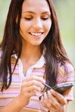 Mulher agradável nova com PDA Foto de Stock Royalty Free