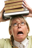 Mulher alarmada sob a pilha de livros na cabeça Imagem de Stock Royalty Free