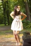 Mulher alegre que ri do por do sol Fotografia de Stock Royalty Free