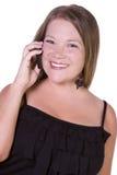 Mulher alegre que sorri no telefone imagem de stock