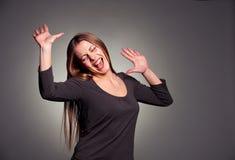 Mulher alegre sobre a obscuridade Imagem de Stock Royalty Free