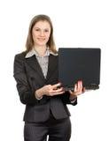 Mulher amigável com um portátil. Isolado no branco Foto de Stock