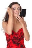A mulher aplica a composição fotografia de stock