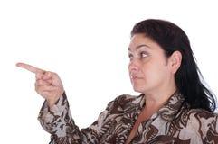 A mulher aponta um dedo foto de stock