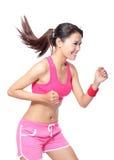 Mulher apta de funcionamento do esporte no perfil Foto de Stock Royalty Free