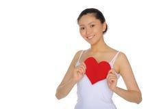 A mulher asiática bonita puxa o coração Fotos de Stock Royalty Free