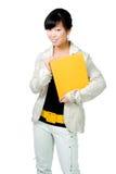 Mulher asiática com livro amarelo e correia Fotos de Stock