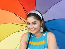 Mulher asiática com um guarda-chuva Fotografia de Stock Royalty Free