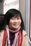 Mulher asiática de sorriso fotografia de stock