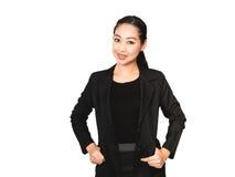 Mulher asiática do negócio feliz no terno preto fotografia de stock