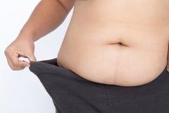 A mulher asiática faz dieta sua gordura da barriga Foto de Stock Royalty Free