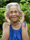 Mulher asiática idosa do retrato com gestos Fotos de Stock