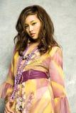 Mulher asiática no vestido imagens de stock royalty free