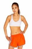Mulher asiática nova bonita no sutiã dos esportes Fotos de Stock Royalty Free