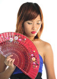 Mulher asiática nova com um ventilador Fotografia de Stock Royalty Free