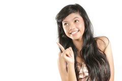 Mulher asiática que tem um pensamento Foto de Stock