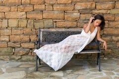 Mulher asiática vestida no laço Fotos de Stock Royalty Free