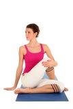Mulher assentada no Pose da ioga Imagens de Stock