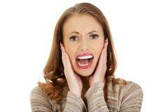 Mulher assustado que grita Fotografia de Stock