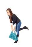 Mulher atrativa com um saco muito pesado Fotos de Stock