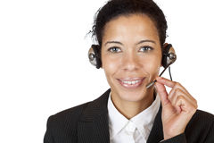 A mulher atrativa de sorriso faz com auriculares um atendimento Imagens de Stock