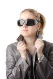 Mulher atrativa em um couro Imagem de Stock Royalty Free