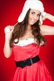 Mulher atrativa no levantamento do traje de Santa imagem de stock
